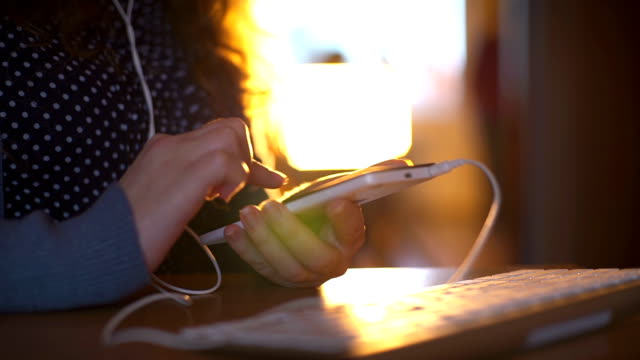 woman is listening music by her smartphone video