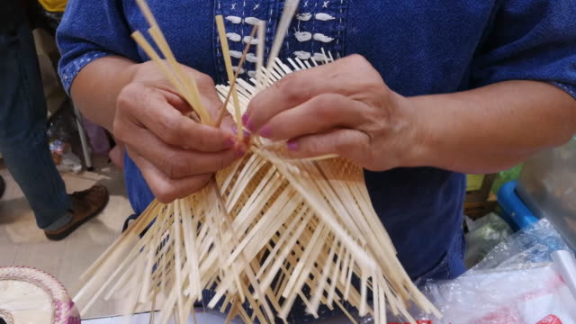 Woman Is Making A Basket By Hand Shot On Smart Phone