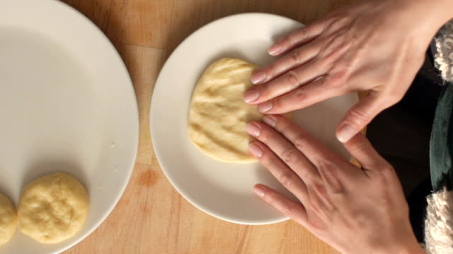 Woman is preparing the dough to make homemade pastry