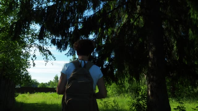 Woman is returning from a forest walk