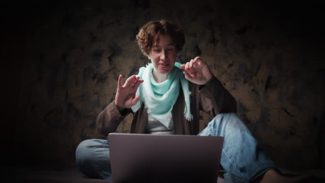 Woman is talking using laptop