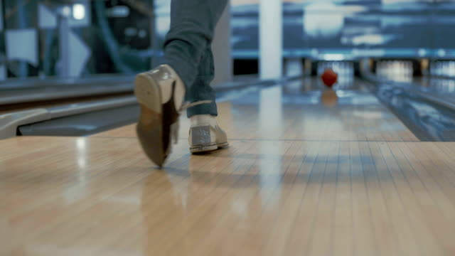 Woman is throwing bowling ball