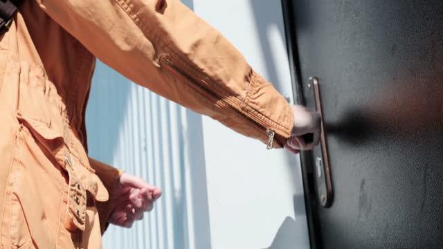 Woman is trying to unlock a door video