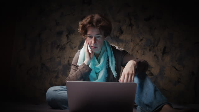 Woman is watching video on laptop
