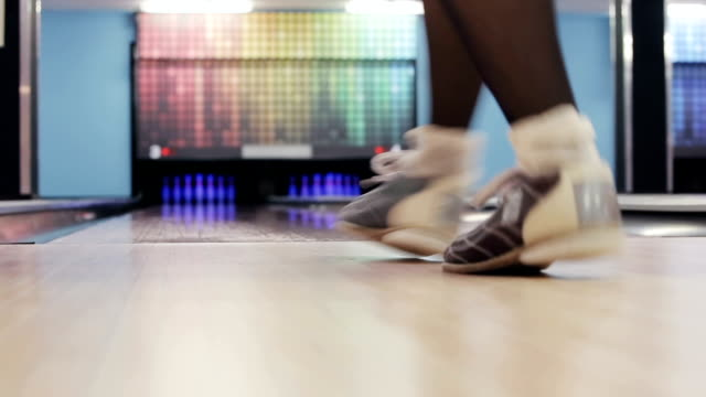 Woman is winning in a bowling game video