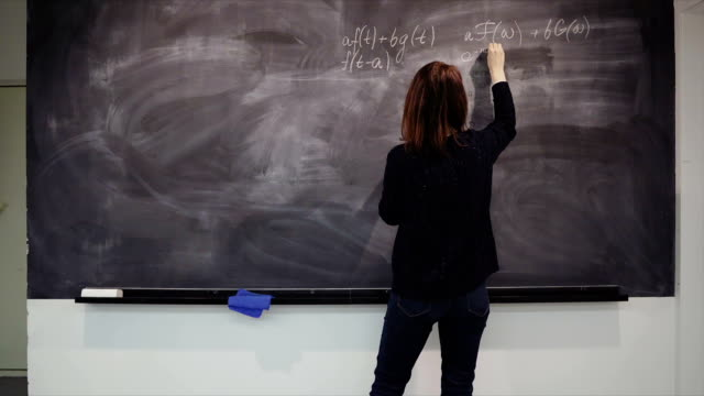 Woman is writing formulas on the desk video