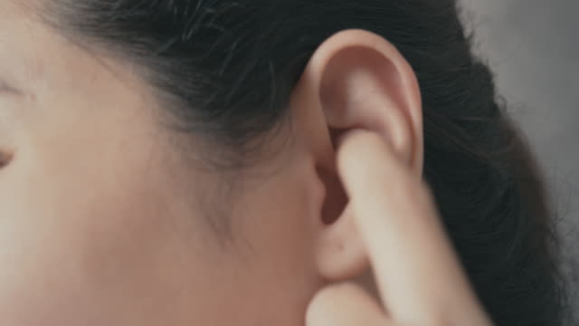 woman itchy and scratching on her ear .health care and medical concept. 4k resolution Asian woman itchy and using her hand scratching on her ear .health care and medical concept. ear stock videos & royalty-free footage