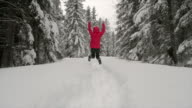 istock woman jumping  in the snowy forest 1199752071