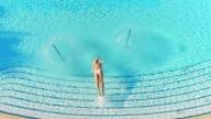 istock SLO MO Woman jumping into the swimming pool 1264141004