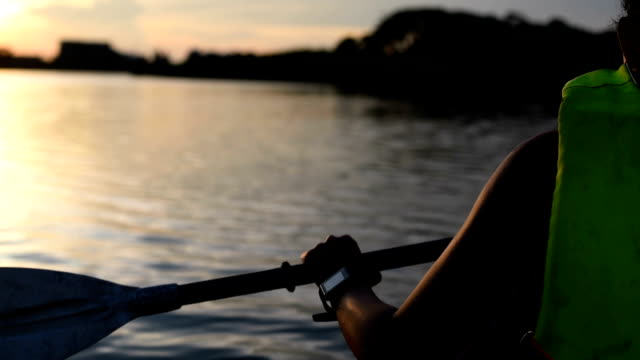 Woman kayaking on the lake in twilight video
