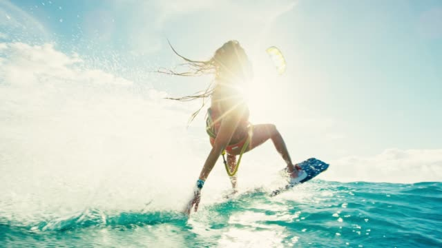 woman kiteboarding at sunset - beach fashion stock videos and b-roll footage