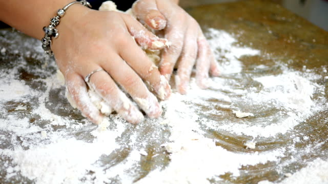 woman kneading dough on kitchen counter - formare pane video stock e b–roll