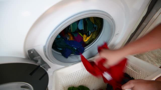 Woman laundry at home Woman laundry at home laundry basket stock videos & royalty-free footage