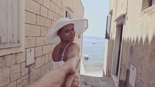 SLO MO Woman leading her boyfriend through alley video
