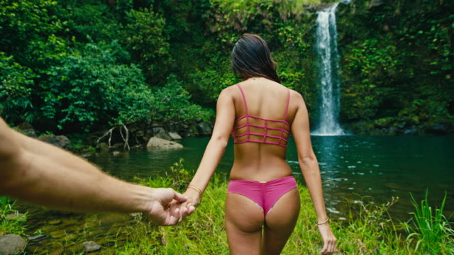 Woman Leading Man to Waterfall video