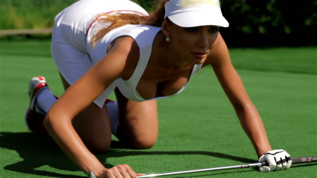 Woman leans on the golf club video