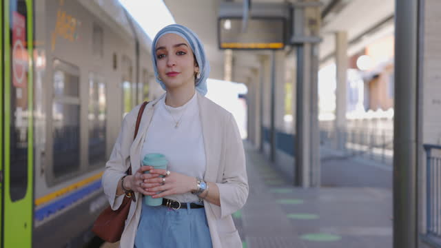 Woman leaving the train station and going to the office video