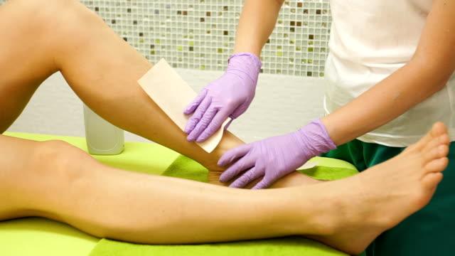 Woman leg waxing video