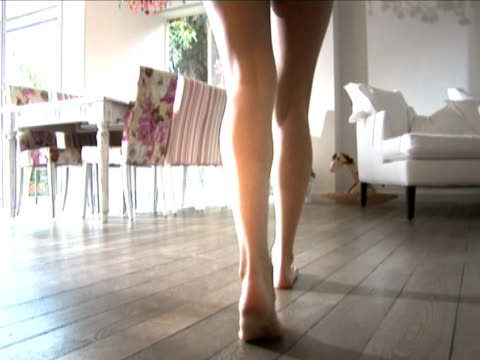 woman legs walking at home video