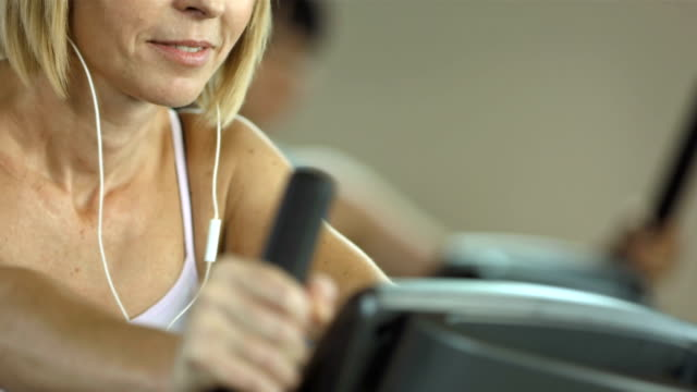 Woman Listening Music While Exercising video