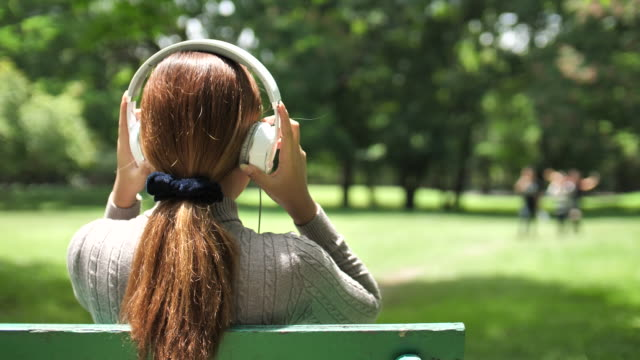 Woman listening to music in Park video