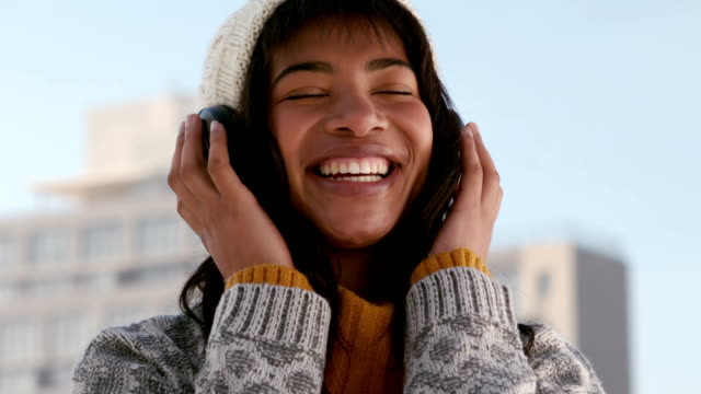 Woman listening to music on a winters day video