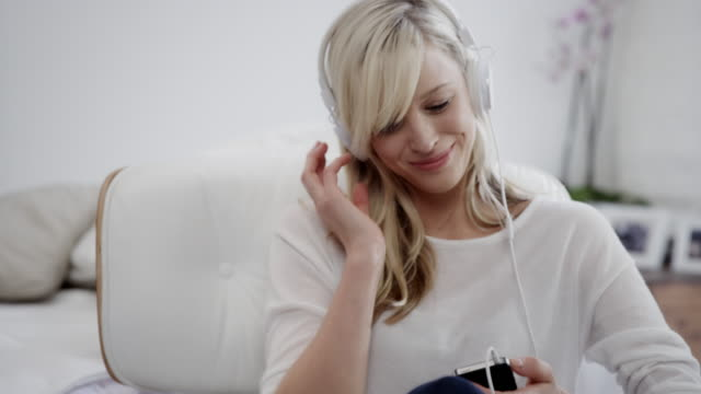 Woman listening to music video