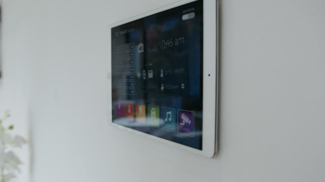 Woman locking her smart home through tablet