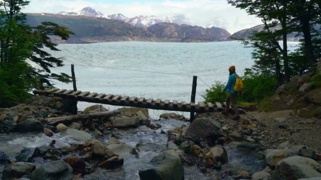 Woman looking at Grey glacier from bridge  in Torres del Paine National Park