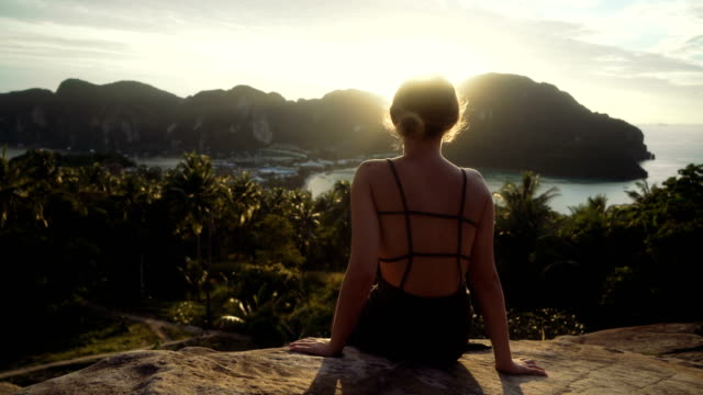 Woman looking at View of Koh Phi Phi Leh from the above video