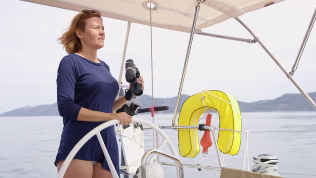 WS Woman looking for direction while sailing video