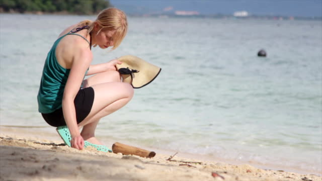 Woman Looking for Seashells on the Beach video