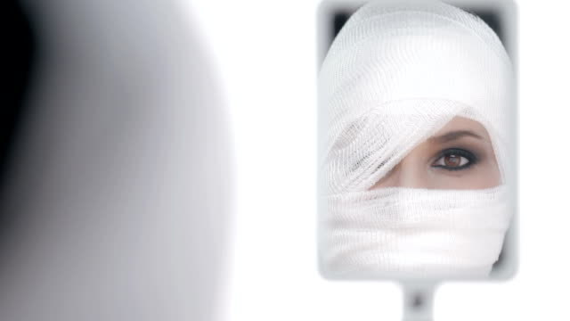 HD: Woman Looking Herself After Face Surgery video