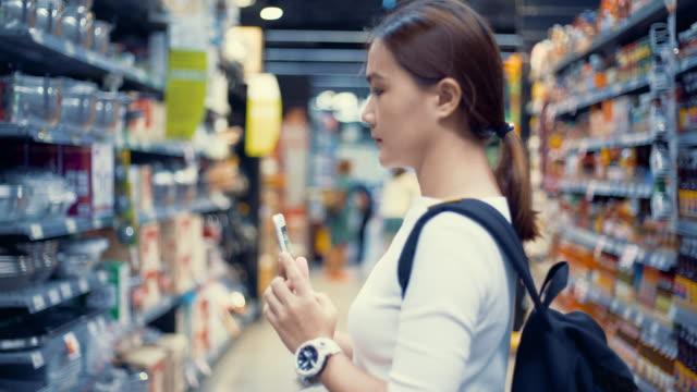 woman looking in supermaket video