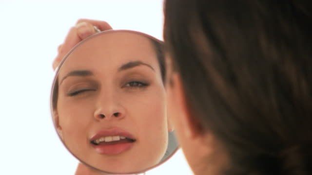 HD: Woman looking into mirror video