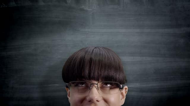 Woman looking up at blackboard