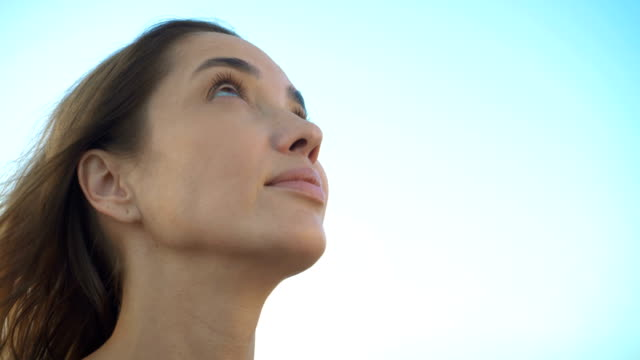 woman looking up to sky with hope pray prayer - gente serena video stock e b–roll