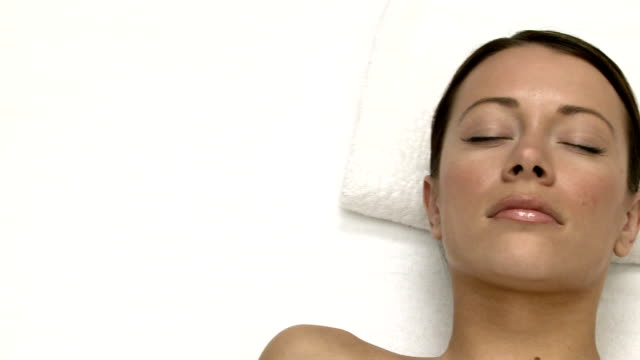 Woman lying on massage table video