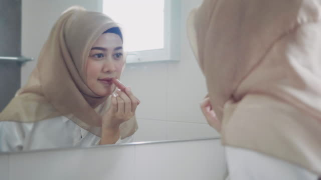 Woman make up in front of the mirror