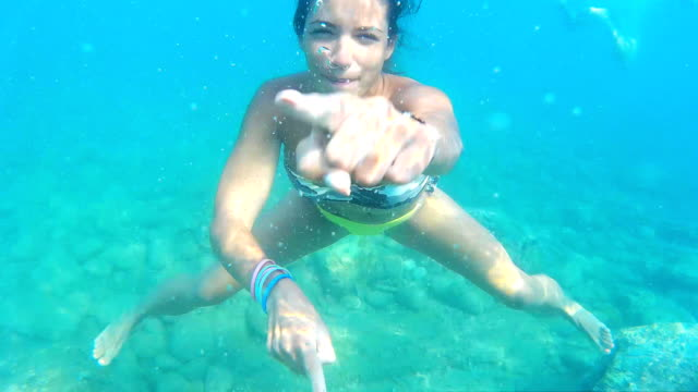 Woman making faces underwater video
