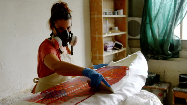 Woman making surfboard 4k Woman making surfboard in workshop 4k fabric swatch stock videos & royalty-free footage