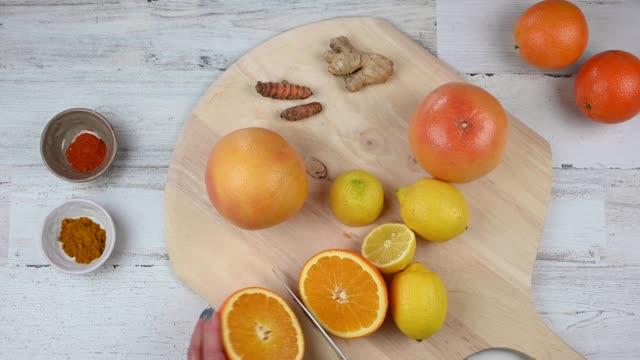 woman making vitamin C health drink recipe