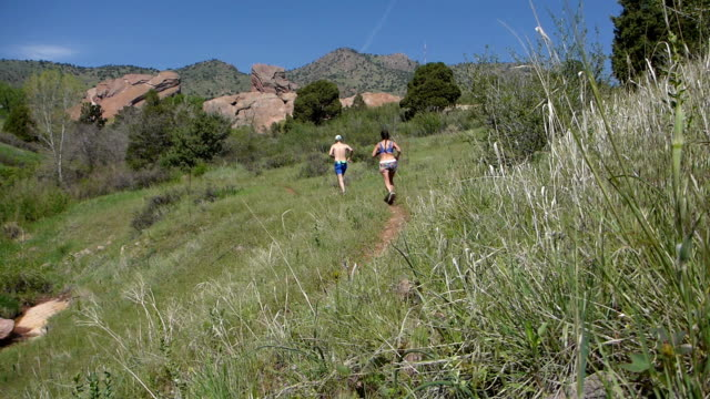 Woman man running Will Call Trail Red Rocks Park Morrison Colorado Rocky Mountains video