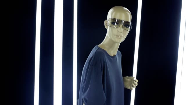 Woman mannequin surrounded by vertical lights video