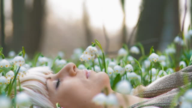 HD DOLLY: Woman Meditating Among Spring Snowflakes video