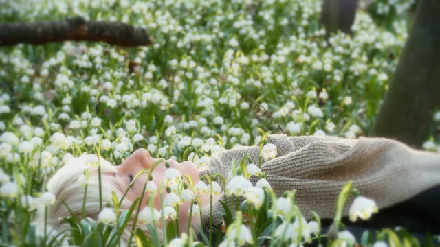 HD DOLLY: Woman Meditating Among Spring Snowflakes video