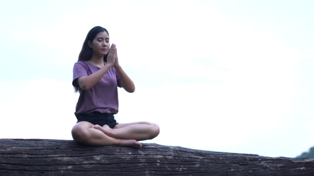 Woman meditation in tropical forest ,women relax in the holiday Woman meditation in tropical forest ,women relax in the holiday cross legged stock videos & royalty-free footage