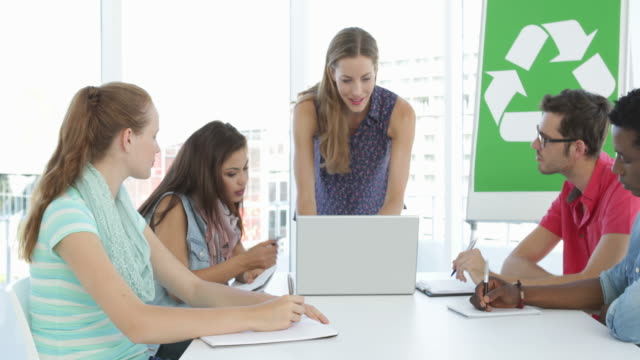Woman meeting with colleagues about environmental awareness