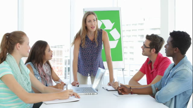 Woman meeting with team about environmental awareness