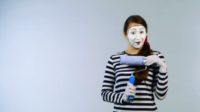 Woman mime invisible wall colors video